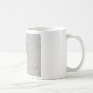 Closeup of beach sand texture background coffee mug