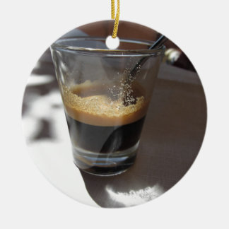 Closeup of espresso coffee in a glass cup ceramic ornament
