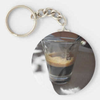 Closeup of espresso coffee in a glass cup keychain