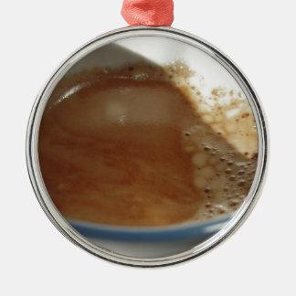 closeup of fresh espresso with coffee foam metal ornament