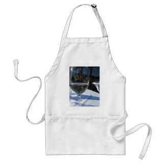 Closeup of glass with white wine adult apron