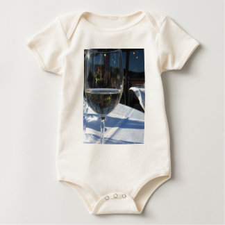 Closeup of glass with white wine baby bodysuit