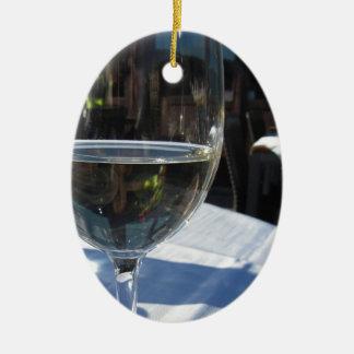 Closeup of glass with white wine ceramic ornament