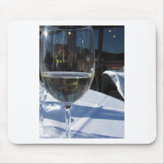 Closeup of glass with white wine mouse pad