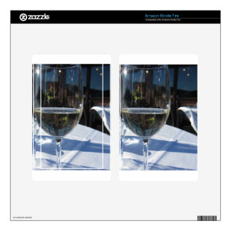 Closeup of glass with white wine skin for kindle fire