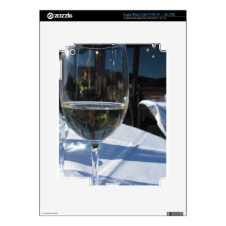Closeup of glass with white wine skins for iPad 3