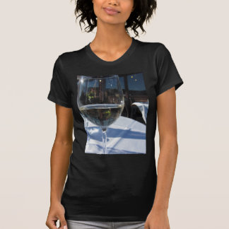 Closeup of glass with white wine tee shirt