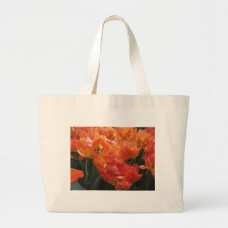 Closeup of orange tulips with droplets in spring large tote bag