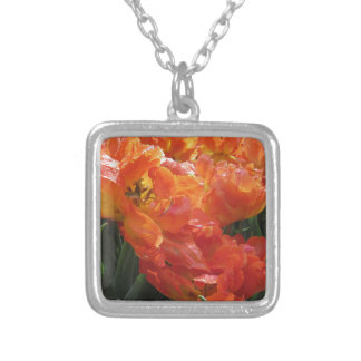 Closeup of orange tulips with droplets in spring silver plated necklace