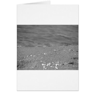Beach Themed Closeup of sand beach with sea blurred background card
