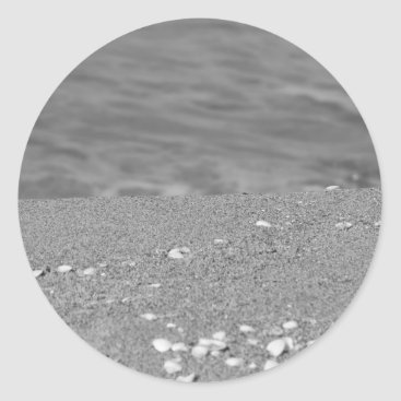 Beach Themed Closeup of sand beach with sea blurred background classic round sticker