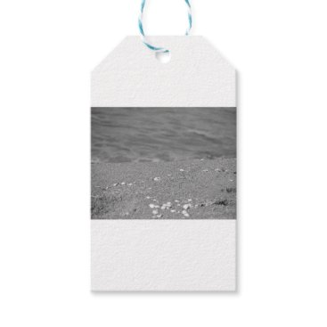 Beach Themed Closeup of sand beach with sea blurred background gift tags