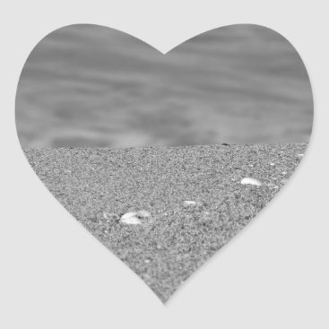 Beach Themed Closeup of sand beach with sea blurred background heart sticker