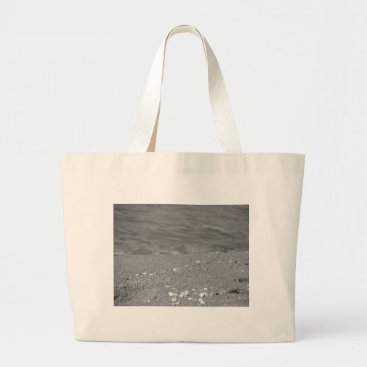 Beach Themed Closeup of sand beach with sea blurred background large tote bag