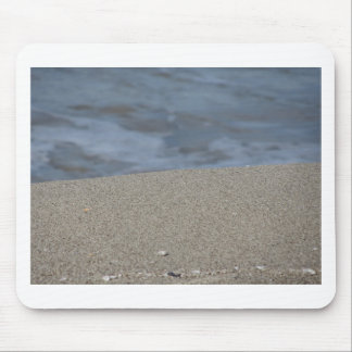 Closeup of sand beach with sea blurred background mouse pad