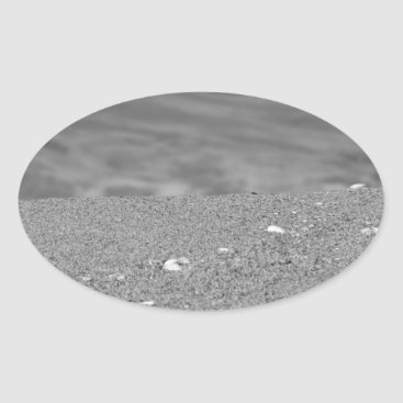 Beach Themed Closeup of sand beach with sea blurred background oval sticker