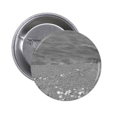 Beach Themed Closeup of sand beach with sea blurred background pinback button