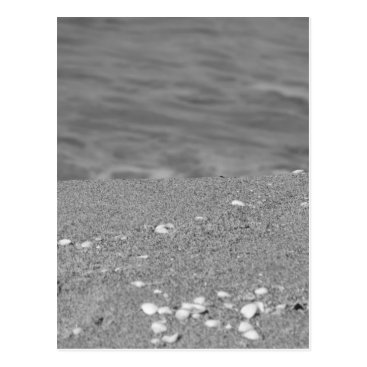 Beach Themed Closeup of sand beach with sea blurred background postcard
