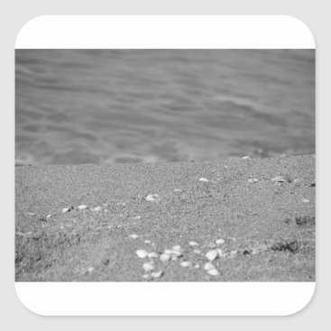 Beach Themed Closeup of sand beach with sea blurred background square sticker