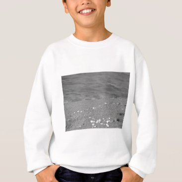 Beach Themed Closeup of sand beach with sea blurred background sweatshirt