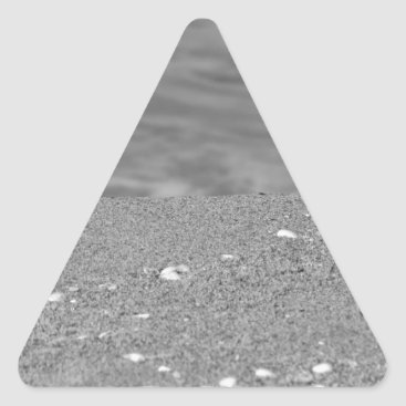 Beach Themed Closeup of sand beach with sea blurred background triangle sticker