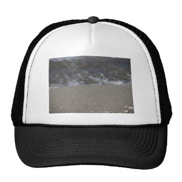 Beach Themed Closeup of sand beach with sea blurred background trucker hat