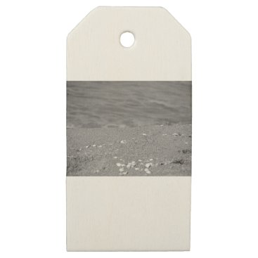 Beach Themed Closeup of sand beach with sea blurred background wooden gift tags