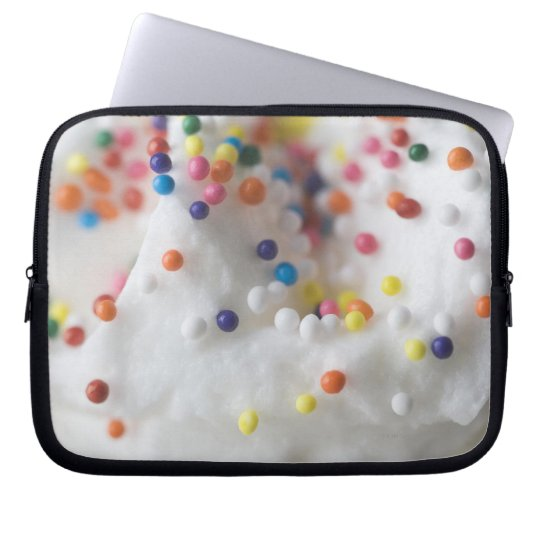 Closeup of sprinkles and frosting laptop sleeve