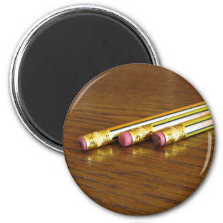 Closeup of used pencil erasers on wooden table magnet