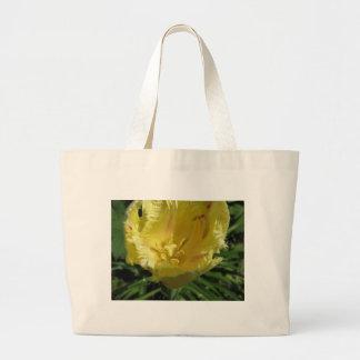 Closeup of yellow tulip in spring large tote bag