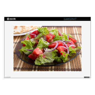 Closeup plate with a salad of chopped tomato slice laptop decal