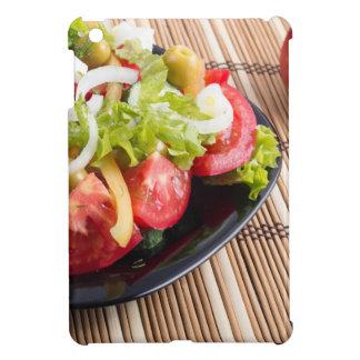 Closeup view fresh natural salad with raw tomato iPad mini case