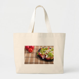 Closeup view fresh natural salad with raw tomato large tote bag