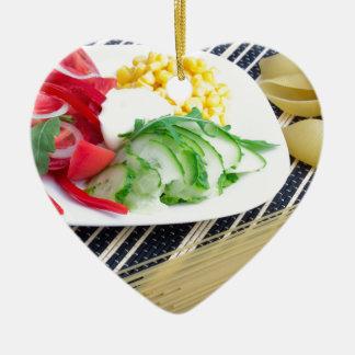 Closeup view of a vegetarian dish of raw vegetable ceramic ornament