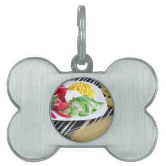 Closeup view of a vegetarian dish of raw vegetable pet ID tag