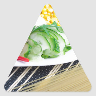 Closeup view of a vegetarian dish of raw vegetable triangle sticker