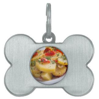 Closeup view of a vegetarian dish of stewed potato pet ID tag
