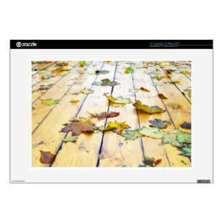 """Closeup view on a wet green and yellow leaves 15"""" laptop skins"""
