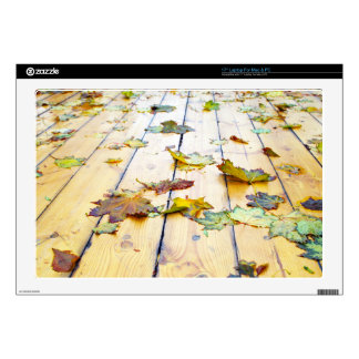 """Closeup view on a wet green and yellow leaves 17"""" laptop skins"""