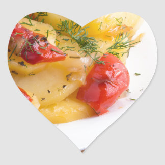 Closeup view on slices of potato stew heart sticker