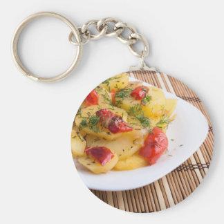 Closeup view on slices of potato stew keychain
