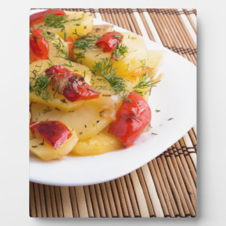 Closeup view on slices of potato stew plaque