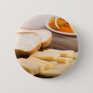 Closeup view on snacks for veggie pinback button