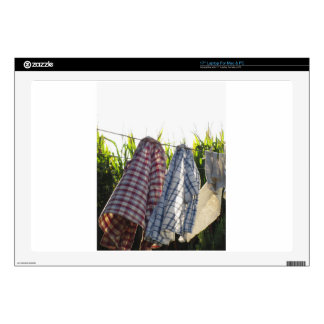 """Clothes are hanging on clothesline 17"""" laptop skin"""