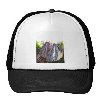 Clothes are hanging on clothesline trucker hat