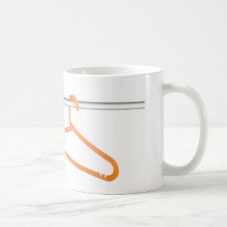 Clothes hanger on rack coffee mug