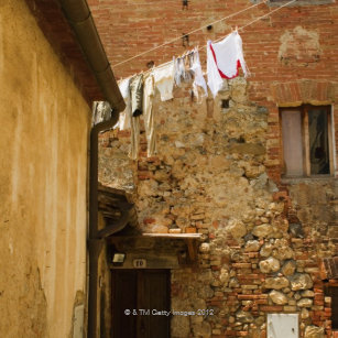 Clothes Hanging To Dry On A Clothesline