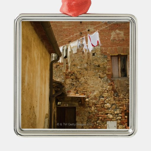 Clothes hanging to dry on a clothesline, metal ornament
