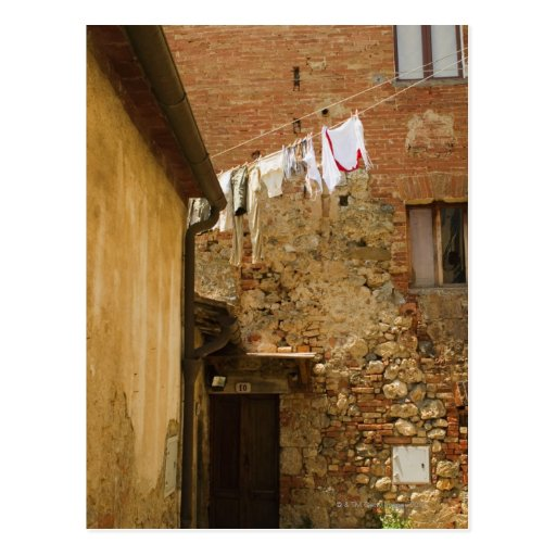 Clothes hanging to dry on a clothesline, post card