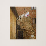Clothes hanging to dry on a clothesline, jigsaw puzzles
